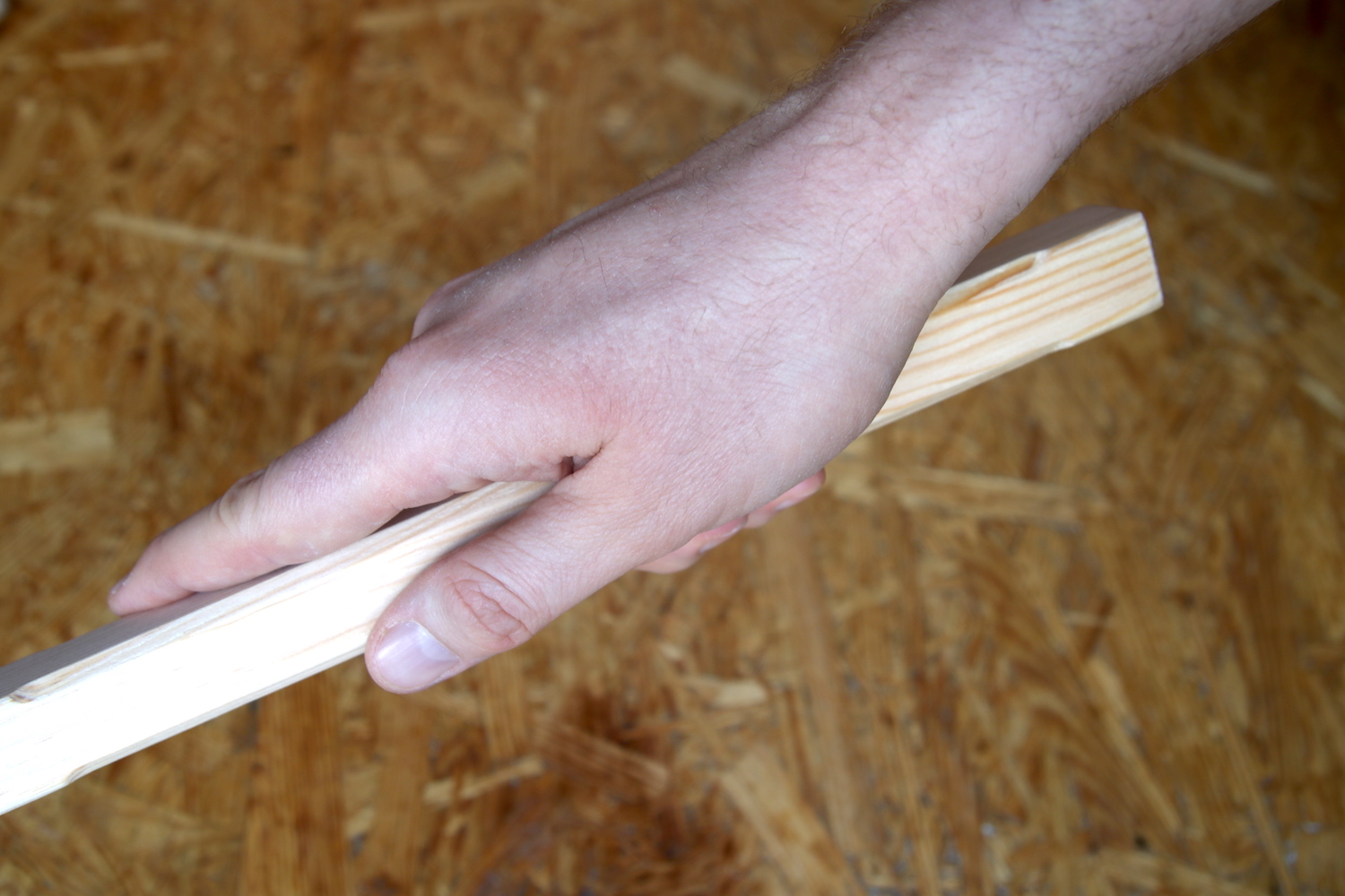 Hand holds handle of Giant Writing Tool